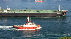 Pilotage service boat sailing into Straits with super tanker ship Stock Footage