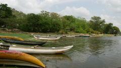 Small fishing boats at a lake in Anuradhapura District of Sri Lanka Stock Footage