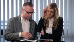 Business people talking at the office. Man showing a woman plans in the notebook Stock Footage