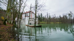 Flooded castle Sneznik with person removing big log Stock Footage