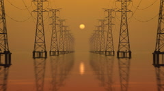 High-voltage towers with sunset in the background. - stock footage