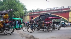 Rickshaws in busy Delhi Intersection timelpase Stock Footage