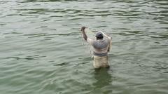 Fishermen throughs a fishing net in a river in Negombo, west coast, Sri Lanka Stock Footage