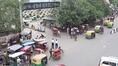 Rickshaws at entrance to New Delhi Train Station Stock Footage