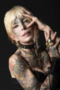 Lady in dark , with tattoo onface with mask Stock Photos