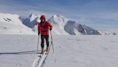 Mountaineer walking on a glacier Stock Footage