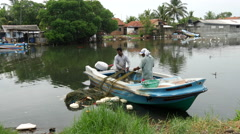Fishermen pick up the nets in Negombo, west coast, Sri Lanka Stock Footage