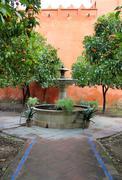 Courtyard at the Real Alcazar Moorish Palace in Seville - stock photo