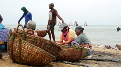 Woman working at the fish market at the beach Stock Footage