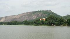Lake with mountain in the Anuradhapura District of Sri Lanka Stock Footage