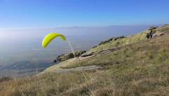 4k paraglider takes off mountain during paragliding extreme sport competition Stock Footage