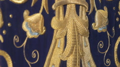 Embroidered mantle for step canopy of the Virgen de la Victoria Stock Footage