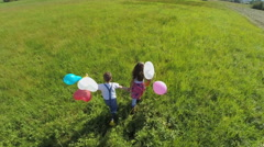 running couple kids with balloons  - stock footage