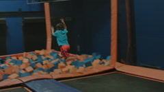 KID JUMPING INTO FOAM PIT 1 Stock Footage