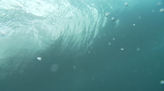 Sufer riding a barrel under water shot Stock Footage