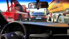 Driving between running dump trucks on the highway Stock Footage