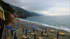 Beach umbrellas Monterosso al Mare, Liguria, Italy Stock Footage
