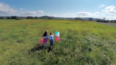 Two kids feel freedom and running with balloons - stock footage