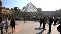 Louvre Museum court yard and palace Stock Footage