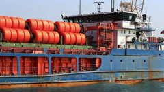 Cargo ship with loaded gas pipes Stock Footage