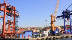 Industrial seaport with containers, cranes and trucks - stock footage