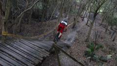 Mountain Bike Wooden Ramp Drop Tree View 5oclock  Stock Footage