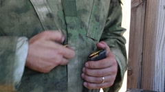 Operator in Camouflage Loads AR-15 Magazine Stock Footage