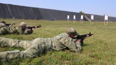 Low Angle View of Shooters Lying then Kneeling While Firing Stock Footage