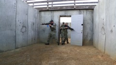 Operators Practice Clearing a Room with Weapons Stock Footage