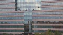 Window Washers on a High Rise Building Stock Footage