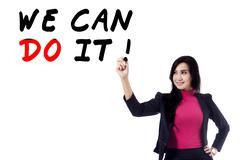 Female leader writes a motivation word Kuvituskuvat