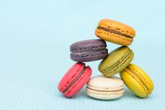 Stock Photo of Colorful macaroon on blue vintage table cloth