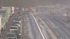 Police at scene of car accident and traffic jam n snow storm on highway Stock Footage