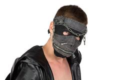 Photo of the brunet man in mask - stock photo