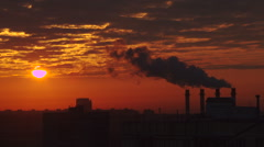 Thermal power station smoke silhouette at sunset Stock Footage