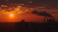 Thermal power station smoke silhouette at sunset - stock footage