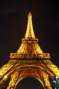 eiffel tower in paris, france at night - stock photo