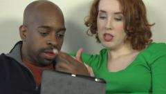 A close-up of an interracial couple agreeing over a tablet. Stock Footage
