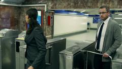 Businesspeople passing metro gate, steadycam shot - stock footage