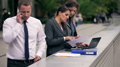Businesspeople working together on public square Stock Footage