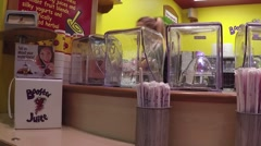 Buying fruit juice at booster juice store Stock Footage