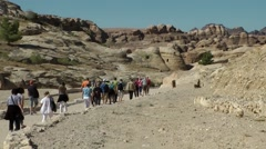 Jordan historical and archaeological city Petra 002 footpath into the valley Stock Footage