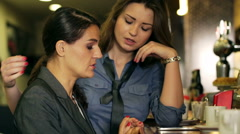 Businesswoman comforting her friend in the pub, steadycam shot Stock Footage