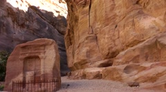 Jordan historical and archaeological city Petra 016 ruins of rock-cut buildings Stock Footage