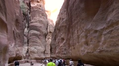 Jordan historical and archaeological city Petra 018 people in a giant gorge Stock Footage
