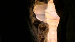 Jordan historical and archaeological city Petra 022 treasury behind gorge exit Stock Footage
