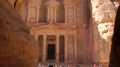 Jordan historical and archaeological city Petra 023 rock face with old treasury Stock Footage