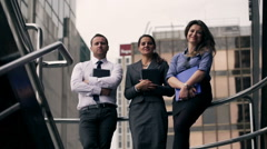 Happy businesspeople standing and looking to the camera - stock footage