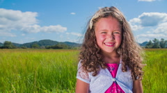 Nice young children girl smile to the camera - stock footage