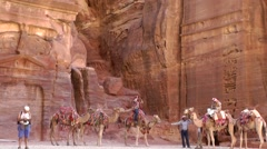Jordan historical and archaeological city Petra 035 pan above rock face Stock Footage